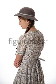 A 1940's girl in a summer dress and hat – shot from eye-level.