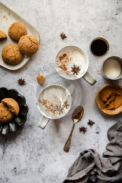 Gingerbread latte with gingersnap cookie.