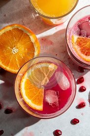 Fresh squeezed pomegranate and orange juice in glasses