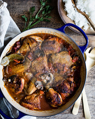 Chicken casserole in a casserole dish on a wooden table