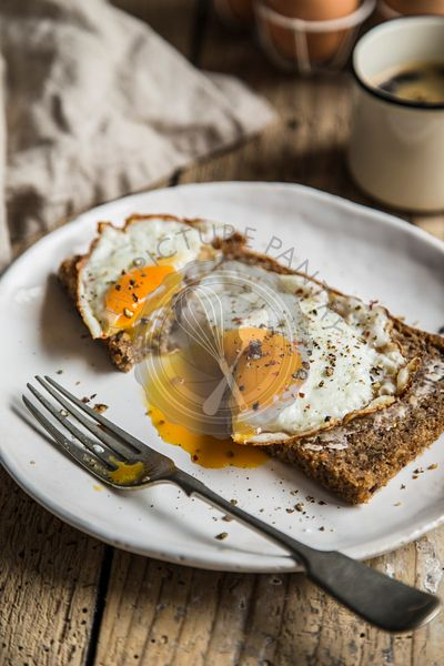 Sunny side up egg on rye bread with butter