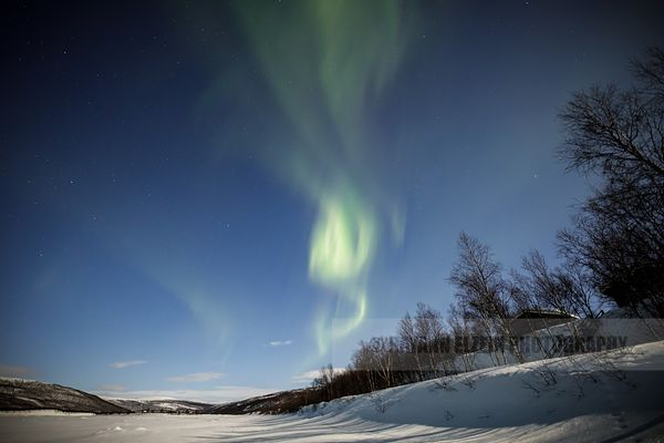 The northern lights above cottages in Utsjoki, Finnish Lapland