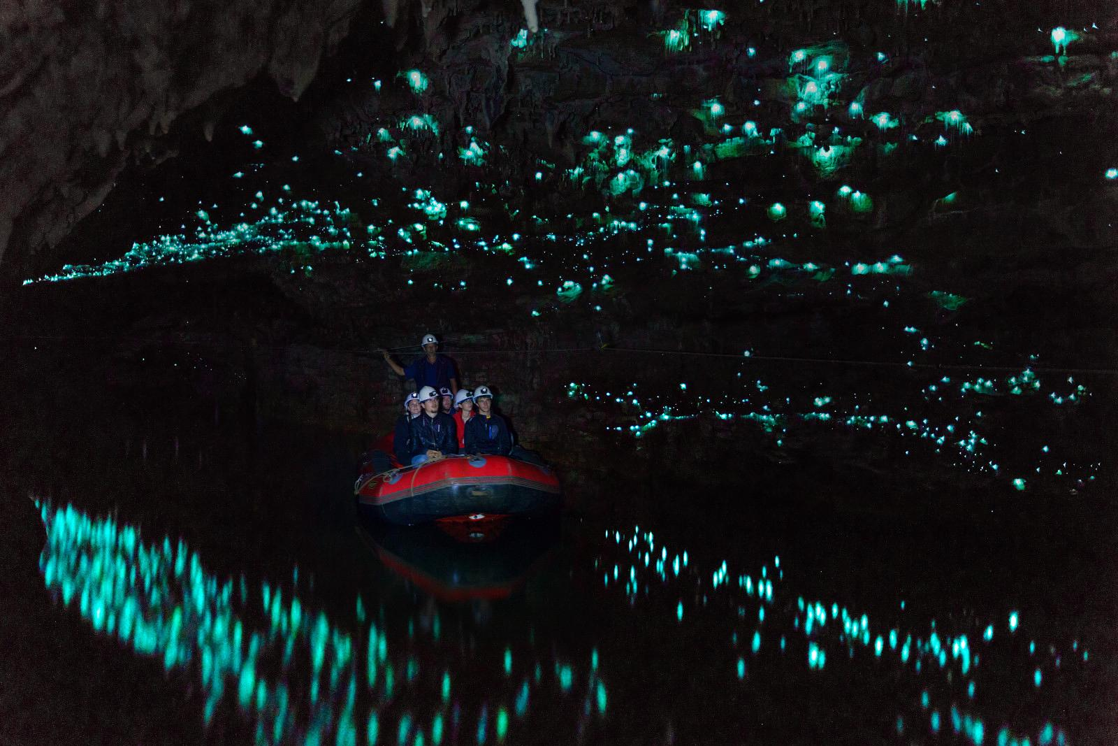 Tourists looking at famous glowworm cave, Waitomo caves, New Zealand