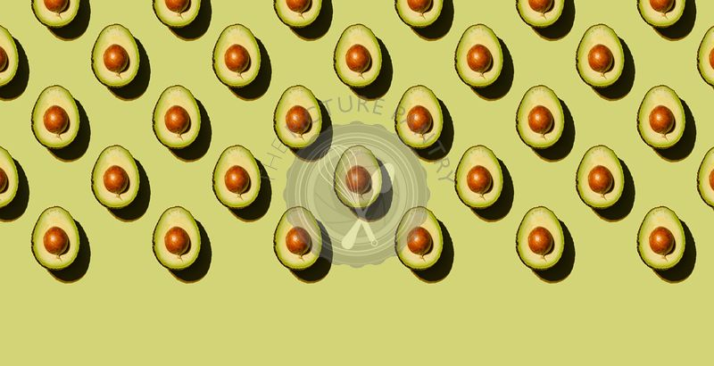 Avocado on green background Pattern