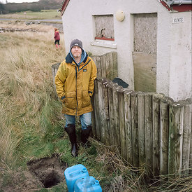 Stuart. Traigh public toilets. Testing soak-away speeds to try and secure planning permission for desperately needed composti...