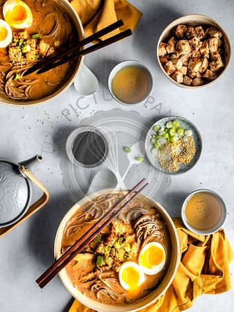 Ramen bowls with chopsticks on a table