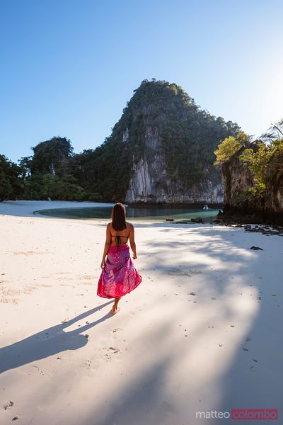 Woman with sarong walking on the beach, Hong island, Thailand