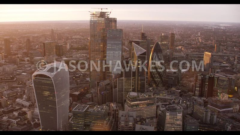 Sunset aerial footage of the City of London. 22 BISHOPSGATE, 100 BISHOPSGATE, CITY OF LONDON, HERON TOWER, LONDON., SALESFORC...