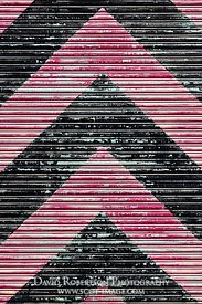 Image - Magenta and black chevron pattern on workshop door, Lyness, Hoy, Orkney, Scotland.