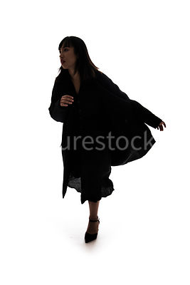 A silhouette of a woman running - shot from mid level.