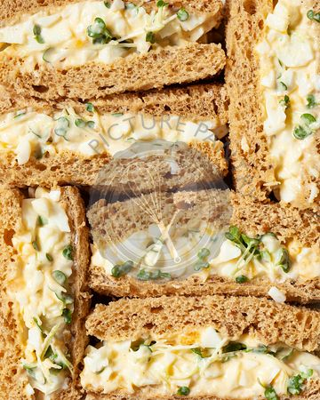 Close up of egg mayonnaise sandwiches made on brown bread