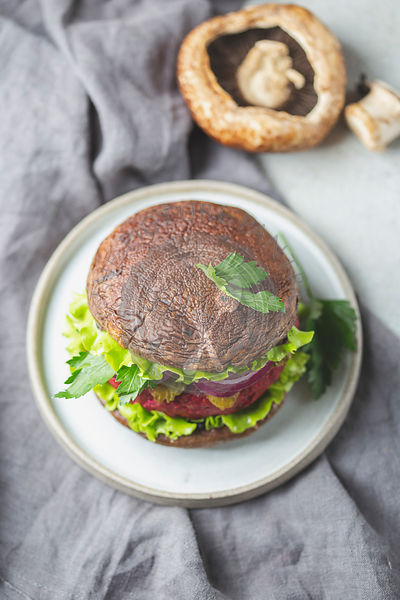 Portobello mushroom bun burger with beetroot cutlet. Vegan, gluten free burger