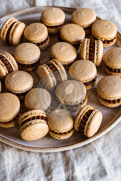 Chocolate french macarons with dark chocolate ganache.