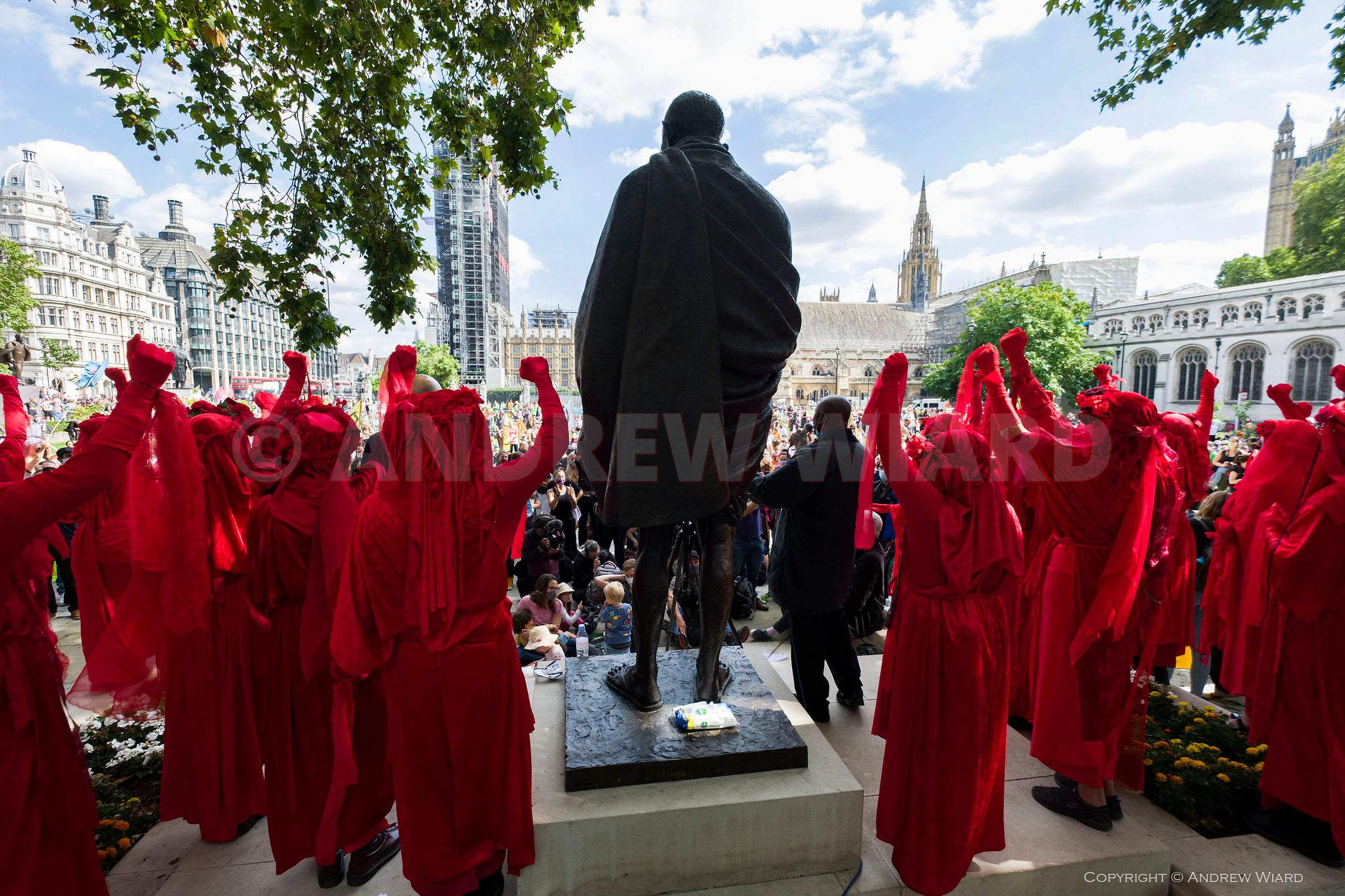 England, UK. 1.9.2020. London. Extinction Rebellion Returns. The Red Brigade at the Ghandi statue, Parliament Square..