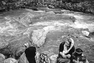 Woman having a picknic near the river at Darband.