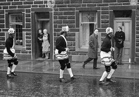 #77100,  The 'Nutters' Dance', Bacup, Lancashire,  1973.  On Easter Saturday every year the 'Coconut Dancers' gather at one b...