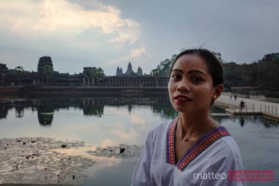Portrait of beautiful asian woman in front of Angkor Wat, Cambodia