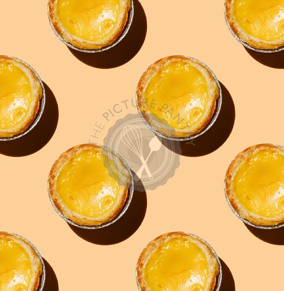 Pastel de Nata Fresh baked Portuguese egg custard Tart on pink background Pattern