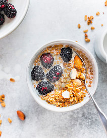 Healthy granola bowl with blackberries and almonds