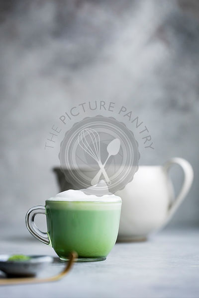 Matcha latte drink on a gray bakground