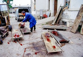 Bosnian Man Cleaning Bloody Stretchers