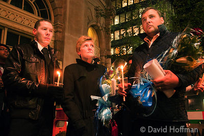 The family of G20 protest victim Ian Tomlinson lead a candlelit vigil to remember his death.