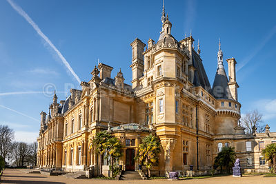 Waddesdon Manor on a sunny day with blue skies and aircraft trails