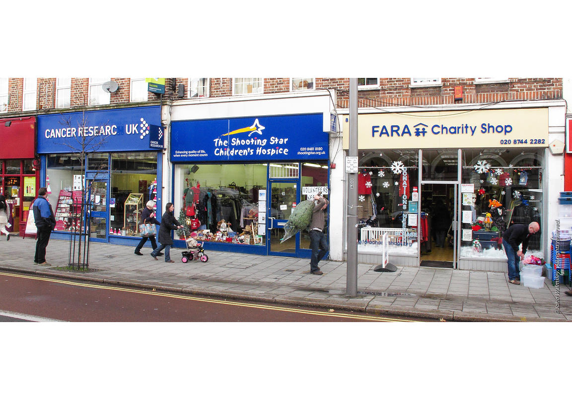 #61320  Three charity shops and a discount store all in a row.  These shops usually spring up when a neighbourhood's income d...