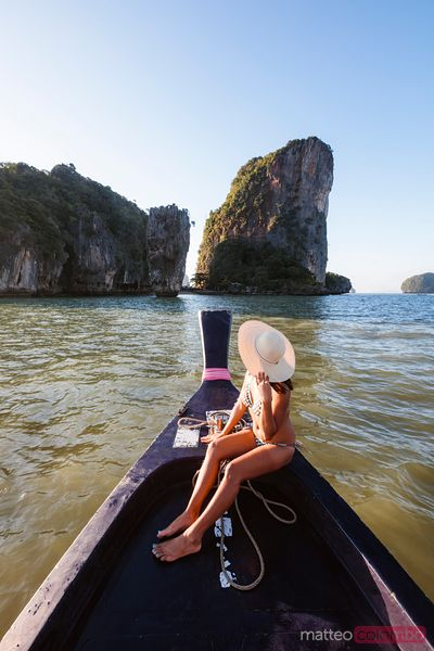 Woman on boat prow, James Bond Island, Phang Nga bay, Thailand