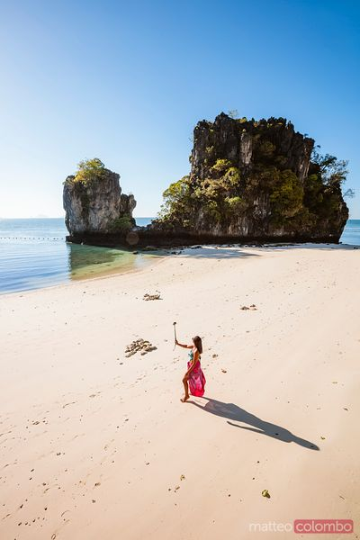 Asian woman with selfie stick at Hong island, Thailand