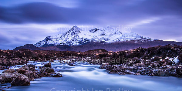 Twilight over the  snow covered Cuillin Hills and River Sligachan