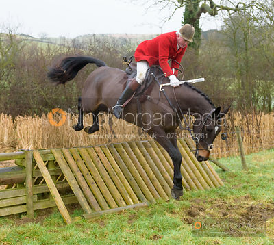 Andrew Osborne jumping a hunt jump after the meet