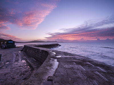 Clouds_over_the_Cobb_-_Lyme_Regis