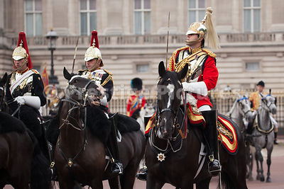 Household Calvalry Soldiers riding past Buckingham Palace