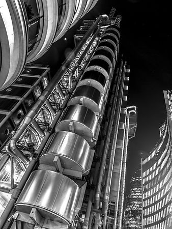 Low angle view of the Lloyds building at dusk, London, UK