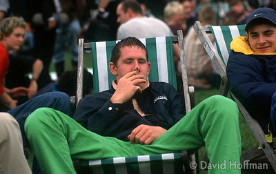 4.211-553 Young man relaxing with a joint (cannabis cigarette) in Hyde park, London.