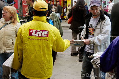 071019_CamdenStreet_003 'London Lite' freesheet newspaper street seller. Camden Town 2007.