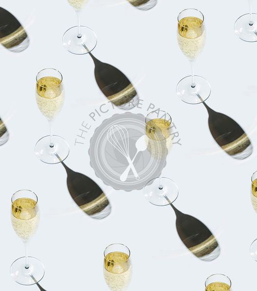 Glass of Champagne on white background Pattern