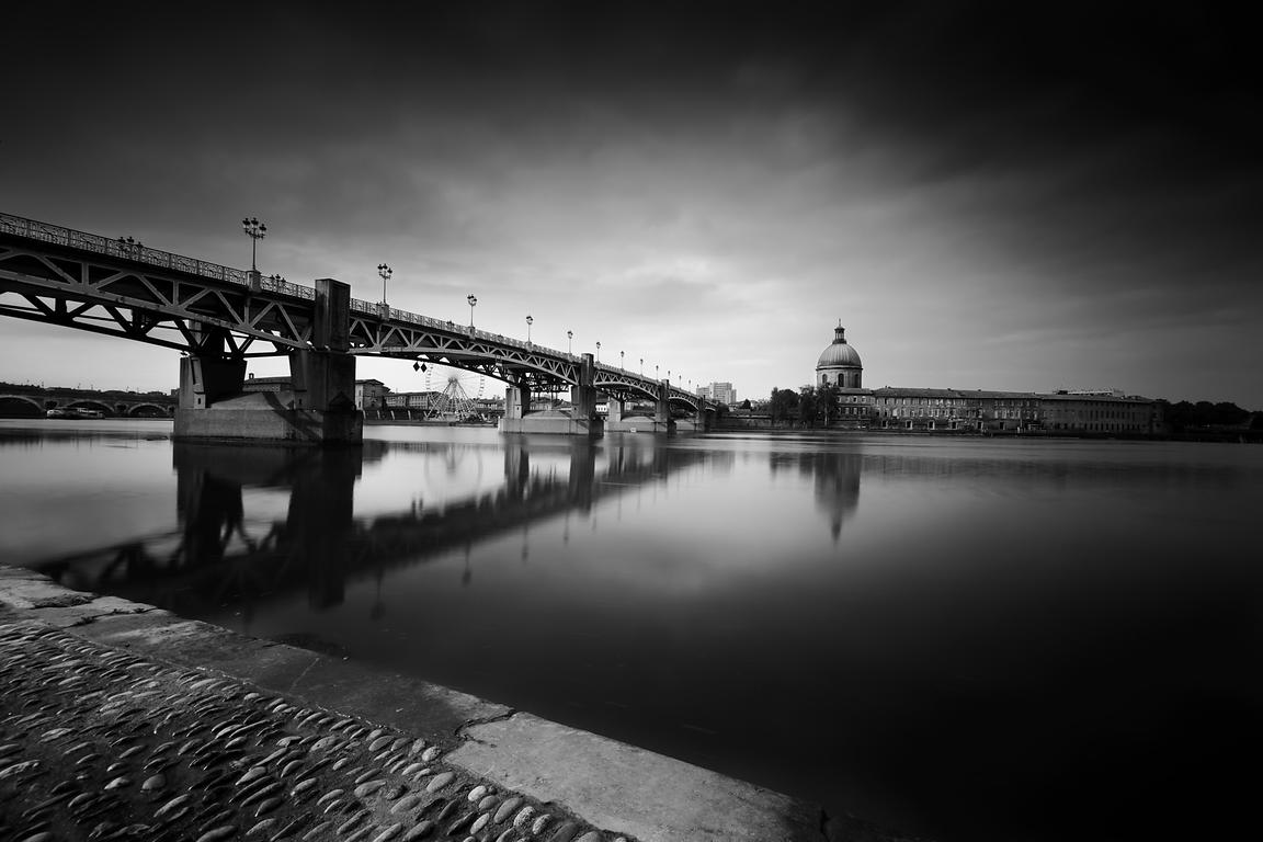 Toulouse city with bridge and old building along the Garonne river, France