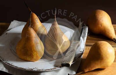 Ripe pears in a rustic setting.