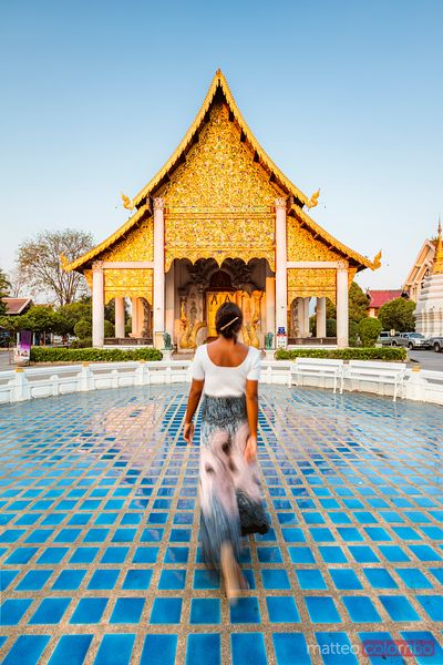 Woman walking to the temple, Chiang Mai, Thailand