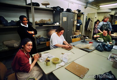 Holloway Prison, London. Warder with prisoners in craft room.