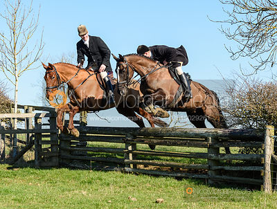 Angus Smales, Sean Frankham jumping a hunt jump at Puss's Bushes. The Cottesmore Hunt at Ladywood Lodge