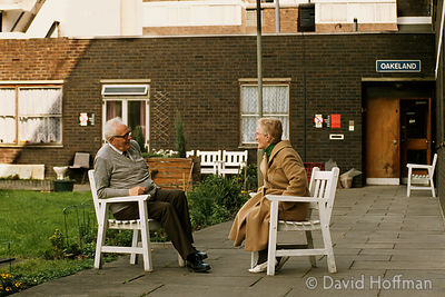 Couple talking outside Oakeland council run residential home for old people in Hackney, London.