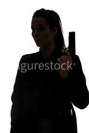 A silhouette, of a tough woman with a gun – shot from eye level.