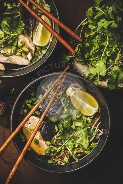 Vietnamese traditional rice noodle and chicken soup Pho Ga, close-up