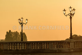 A graphic resource of a section of the Ponte della Vittoria (Bridge of the Victory) at sunset, located in Verona on the river...