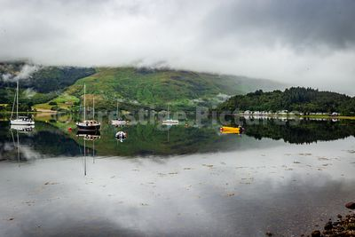 Moored boats sitting on the beautiful Loch Leven at Glencoe