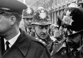 #70461,  Police officers were pelted with flour bombs in Grosvenore Square, anti-Vietnam war demonstration march from Trafalg...