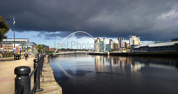 NEWCASTLE UPON TYNE, ENGLAND, UK - SEPTEMBER 09, 2019: The Gateshead Millennium Bridge over the River Tyne from Newcastle's Q...